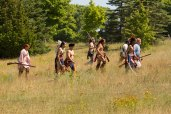 Menominee warriors head into the woods to prevent the American flanking maneuver.